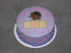 Doc McStuffins cake.  I used the frozen buttercream transfer method for the picture