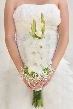 Bridesmaids flowers incorporated within the bouquet. Gladiolus flowers could be a brighter color, maybe red or orange.