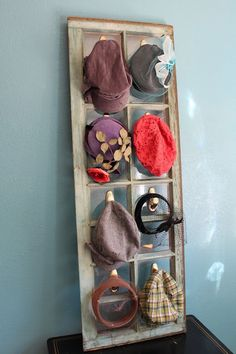 Use an old window for hanging hats or scarfs.