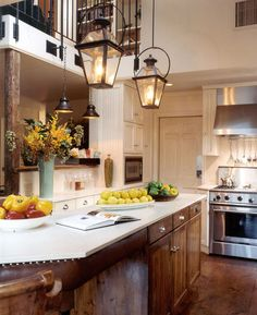 Lanterns in the kitchen! Fab idea..gives off more light than those little pendant lights