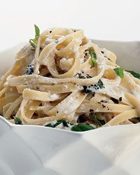 Summery Fettuccine Alfredo | This extra-light Alfredo sauce for pasta gets its silkiness from fresh ricotta and grated pecorino cheese.