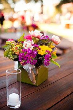 Colorful cocktail #centerpiece in olive green vase by Michael Daigian Design #Weddings