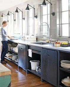 Channeling an industrial look, this kitchen, featured in Martha Stewart Living earlier this year creates a statement through a series of Boston Functional Two-Arm Wall Lights. Def the lights, and the open shelves!!!