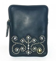 Cofi Case - Western Tablet/eBook CoFi Case - Cheyenne, $109.99 (http://store.coficase.com/western-tablet-ebook-cofi-case-cheyenne/) CoFi's Cheyenne black leather iPad case is adorned with decorative nailheads and rhinestones, including its rhinestone studded leather zipper pull. This unique tablet case is the perfect combination of class, style, and eye-popping bling!