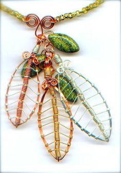 LEAF TUTORIAL - mixing the colors is fun and looks like fall.  Nice detail here. #wire #jewellry #tutorial
