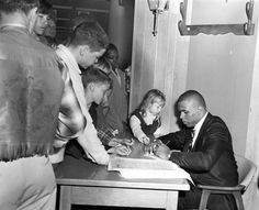 Omaha Central grad Gale Sayers, an all-pro halfback for the Chicago Bears, signed autographs for 2 1/2 hours in the Sears store at Crossroads Mall on April 22, 1967. THE WORLD-HERALD