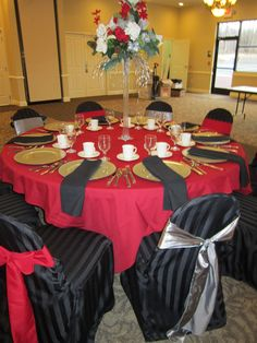 Red Table Cloth, Black Chair Covers!  Great Idea for a Black and Red Theme!