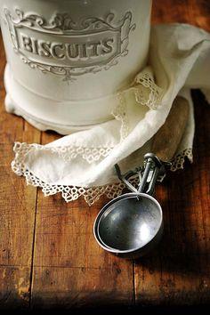 Vintage country kitchen icecream scooper, crochet trimmed napkin and biscuit jar