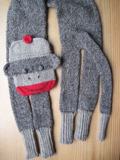 Sock Monkey Scarf! by Evelyn A. Clark. Super cute. $7.95 for the pattern. Knit in worsted weight yarn.