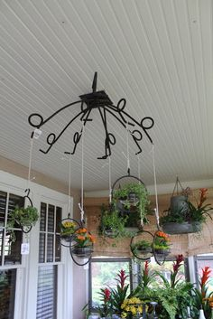 hay hook as a chandelier over outdoor dining table