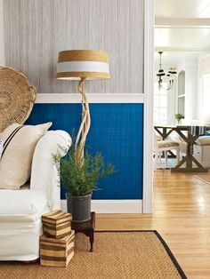This wall paint was texturized to create a faux-fabric effect. Below the crisp white chair rail, @behrpaint Cornflower Blue is topped by a crisscross pattern of Mesmerize over Starless Night, evoking the warmth of your favorite jeans. Above it, @behrpaint Ashwood is topped by a one-way pattern in Ultra Pure White for a look that's closer to starched linen. | Photo: Wendell T. Webber