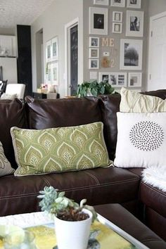 Brown leather couch with gray wall and green accent