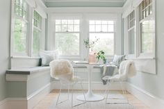 House of Turquoise: Emily Henderson - a modern sunroom with tulip table and white metal mesh chairs