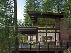 The qualities that made Johnny Bellas's property on British Columbia's Gambier Island attractive—a steep slope draped with trees overlooking a waterfront panorama of Howe Sound—are also a builder's nightmare. However, Bellas was confident that the TD3 2490 model from Lindal Cedar homes, designed by Turkel Design and part of the Dwell Homes Collection, would rise to the challenge. He fell in love with its midcentury sensibilities, great room with soaring 18-foot-high ceilings, ample ...