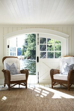 love the doors to this lake cottage