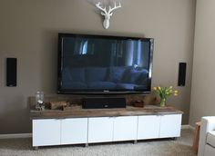 """this is it! the credenza-ish piece Ive been looking for! DIY Entertainment Center created from 15"""" refrigerator wall cabinets from Ikea and rustic wood...."""