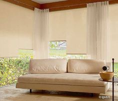 Roller blind and curtain