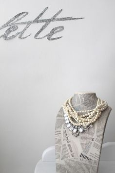 Jewelry Bust paper mâché with newspaper - great idea to show off a dazzling piece of jewelry.