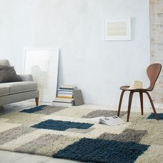 Inspired by decorative prints from the runway, our plush Abstract Wool Shag Rug is handcrafted by Craftmark-certified artisans in India and features long pile New Zealand wool. It transforms hard floors into soft texture while adding a bit of contemporary art to your living room or bedroom.