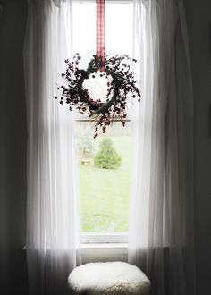 Hang a wreath in a window to create a lovely silhouette! #holiday