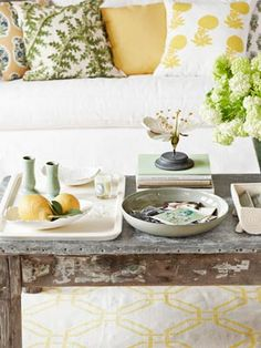 The cheapest accessories are those you already own. Grab a bowl from the kitchen to display photos and postcards. Stack books to form risers that elevate eye-catching objects. And call upon a vintage planter to double as a handy, and handsome, remote control caddy.