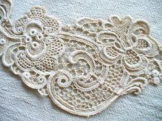 Lace applique from wonderbarrel via Etsy.