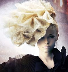 A long blonde straight quirky avant garde wavy frizzy frizzed tig hairstyle by D Ambrose