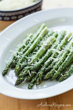 Roasted Asparagus with a light sprinkle of Parmesan cheese. Classic, easy, and elegant.