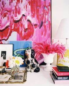 Groupings of art + books + decorative accessories.