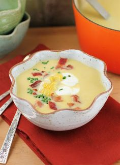 A summer corn soup garnished with creme fraiche, chives, fresh corn kernels, and bacon!  #soup #corn #bacon