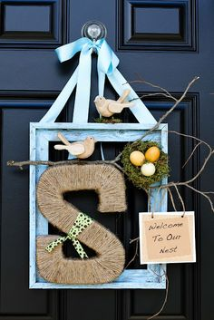 Spring Wreath to greet guests. Embellish painted frame, letter wrapped with jute, branch, ribbons, birds, and mini nest.