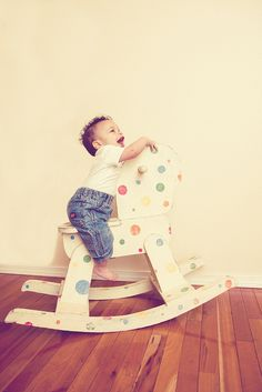 colored dots on rocking horse