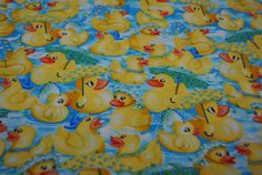 SALE - Robert Kaufman Rainy Day Ducks. $9.00, via Etsy.