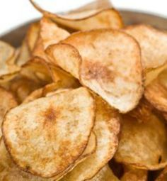 Microwave Fat-Free Potato Chips! Potato chips have always been my down fall. I made these tonight and the whole family loved them. This will help me get through those terrible cravings. And it only took 5 minutes! | via @SparkPeople #food #recipe #snack #healthy
