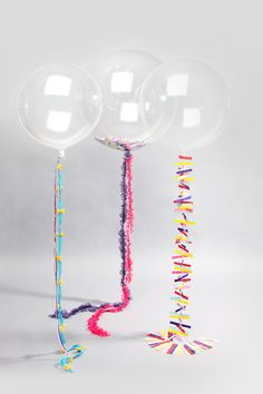 Clear balloons and our wedding colors for the string? We could even put something inside the balloons..