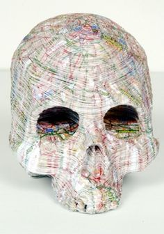 skull made out of maps by eve