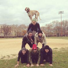 Maddie on a Pile o'Boys.
