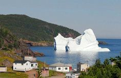 Apparently, in Newfoundland and Labrador, it's quite common for icebergs to hit the shoreline or come mighty close to it    .......this is true, this is a common scene in spring and early summer. VP