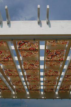 fabric woven into pergola for shade