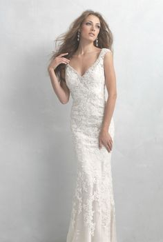 Madison James by Allure - Marilyn. This incredible column sheath gown hugs every curve and is dappled with lace blooms throughout. Fabric: Lace and Satin.
