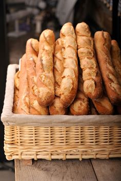 baguettes...on the bus home after a long day, joined by many tired working folks, baguettes fresh from the bakery, everyone tearing off a piece and savoring the taste, riding home on the bus, in the rain, in Paris. (M.New)