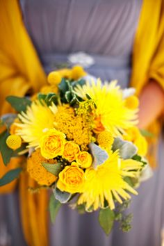 yellow bouquet with a gray dress  we could easily change this to the purples