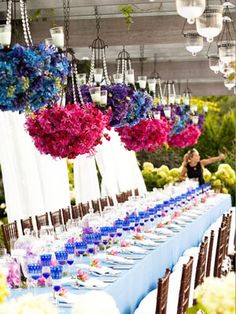 Hanging flower chandeliers #table #flowers
