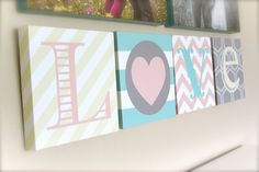 LOVE canvas art letters by Polka Dots & Daisies! Can be done in any colors. Stripes and chevron :)