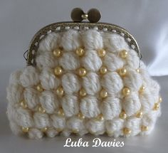 Sweet the way these crochet BOBBLES are BEADED (coin purse pattern by Crochet- atelier in Ravelry)