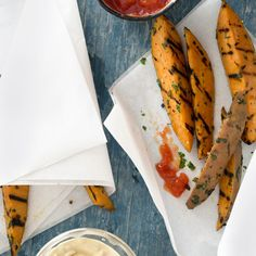 Garlicky Sweet-Potato Fries -- These grilled sweet-potato wedges offer a healthy alternative to fried russets! #myplate #vegetables #protein