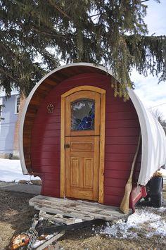tiny house, tiny house. this is a tiny house on wheels shaped like an old time caravan