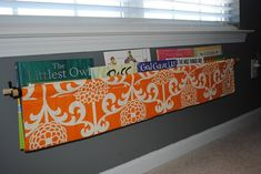 Fabric book sling instead of shelving - so kid-friendly!