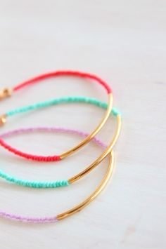 easy to make with some cheap gold bangles + friendship bracelet thread