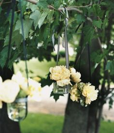 I love flowers hanging from trees with ribbon